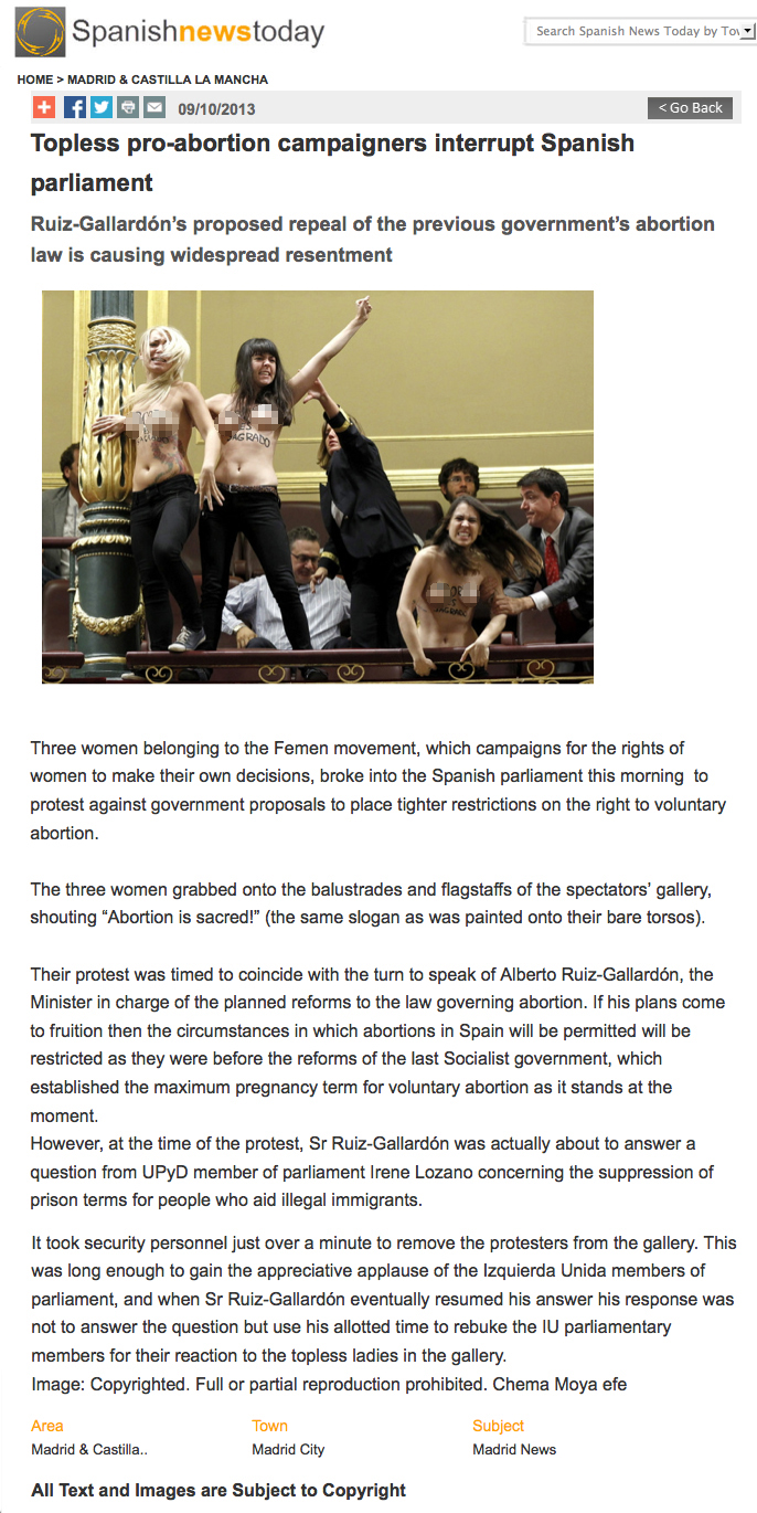 Topless pro-abortion campaigners interrupt Spanish parliament
